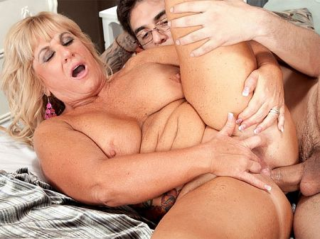 51-year-old sucks balls, takes a 21-year-old cock in her ass