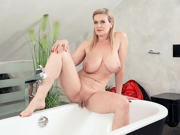 Busty, multi-pierced wife gets wet and sudsy