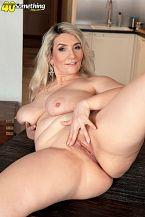 Meet Sandy, a MILF with big boobs