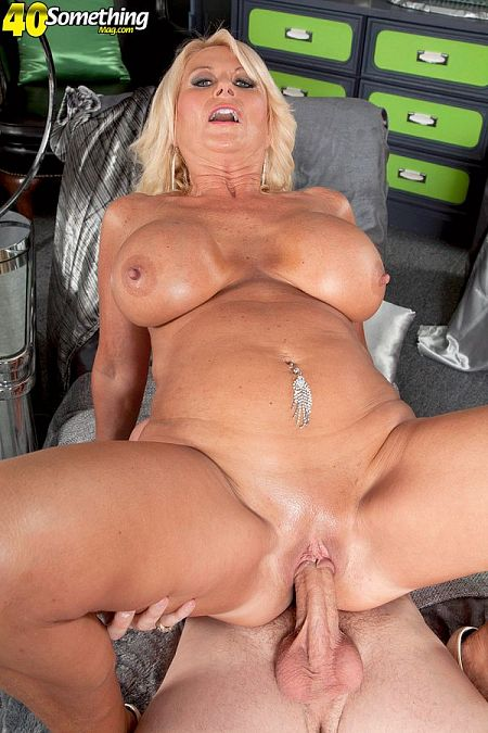 Big-titted, hard-nippled MILF gets fucked