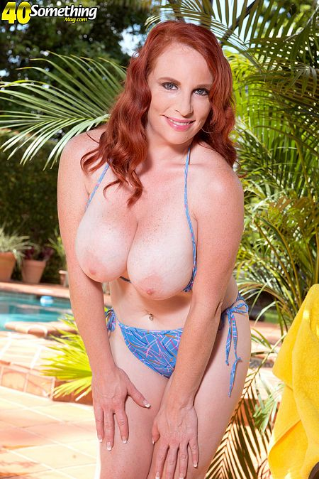 Pool time with a busty, redheaded MILF