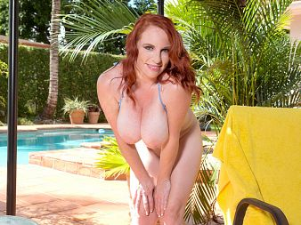 Red Vixen, busty bikini MILF