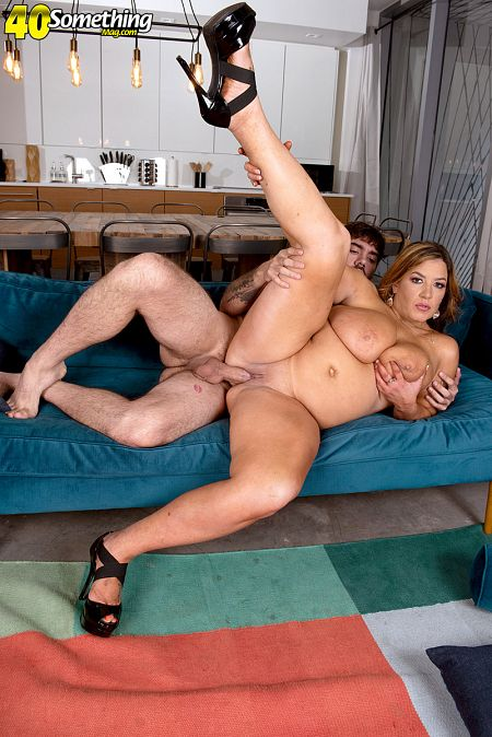 The big-titted step-mom fucks her step-son